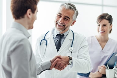 doctor shaking patients hand